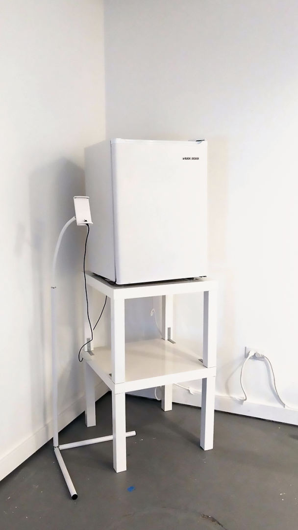 A mini-fridge on top of a table.